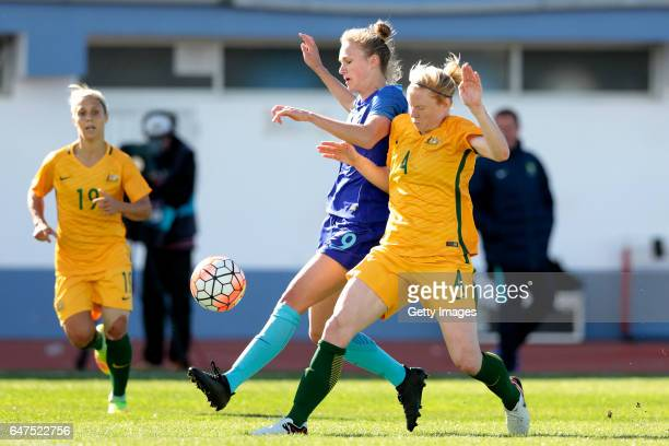 Clare Polkinghore of Australia chalenges Vivianne Miedema of Netherlands during the Algarve Cup Tournament Match between Australia W and Netherlands...