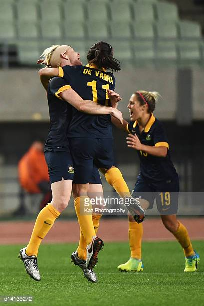 Clare Polkinghorne and Lisa De Vanna of Australia celebrate their qualification to the Rio de Janeiro Olympic after their 2-1 win in the AFC Women's...