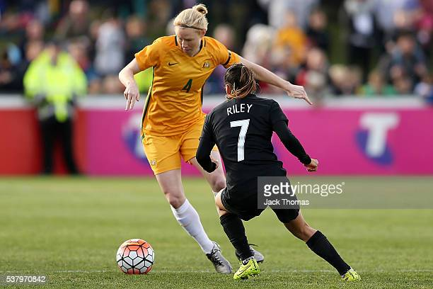 Clare Polkinghorne of Australia and Ali Riley of New Zealand compete for the ball during the women's international friendly match between the...