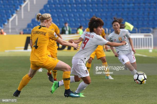 Clare Polkinghorne of Australia and Mana Iwabuchi of Japan in action during the AFC Women's Asian Cup Group B match between Japan and Australia at...