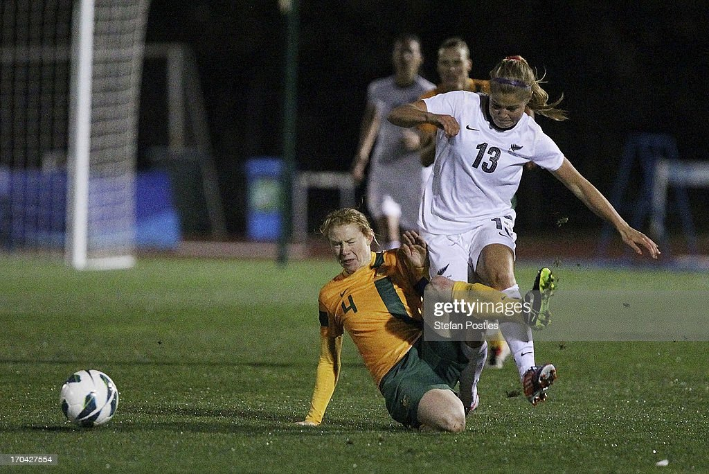 Clare Polkinghorne of Australia and Rosie White of New Zealand contest possession during game one of the Women's International Series between the Australian Matildas and the New Zealand Football Ferns at AIS on June 13, 2013 in Canberra, Australia.