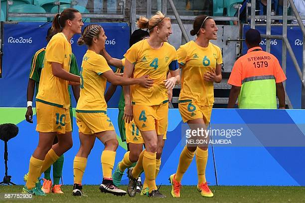 Clare Polkinghorne of Australia celebrates her goal with teammates scored against Zimbabwe during the Rio 2016 Olympic Games womens first round Group...