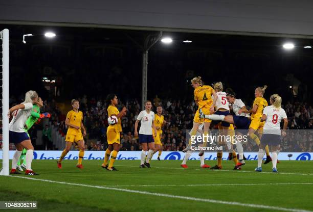 Clare Polkinghorne of Australia scores her sides first goal during the International Friendly between England Women and Australia Women at Craven...