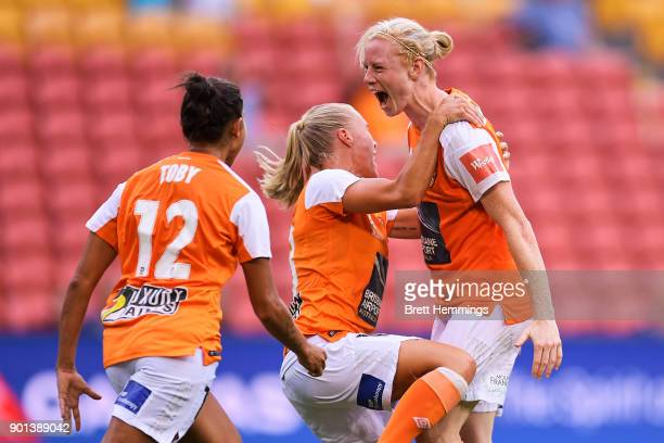 Clare Polkinghorne of Brisbane celebrates scoring a goal with team mates during the round ten WLeague match between the Brisbane Roar and Melbourne...