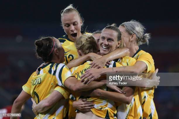 Clare Polkinghorne of the Australian Matildas celebrates her goal with team mates during the Women's Olympic Football Tournament PlayOff match...