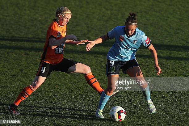 Clare Polkinhorne of the Roar and Caitlin Foord of Sydney FC compete for the ball during the round one WLeague match between the Brisbane Roar and...