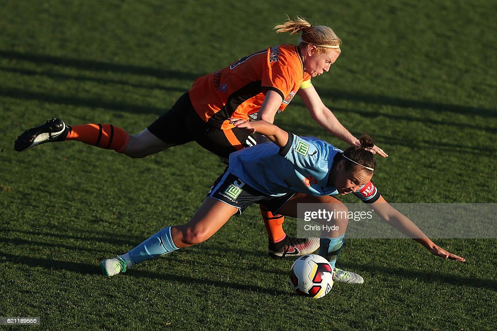 Clare Polkinhorne of the Roar and Caitlin Foord of Sydney FC compete for the ball during the round one W-League match between the Brisbane Roar and Sydney FC at Spencer Park on November 5, 2016 in Brisbane, Australia.