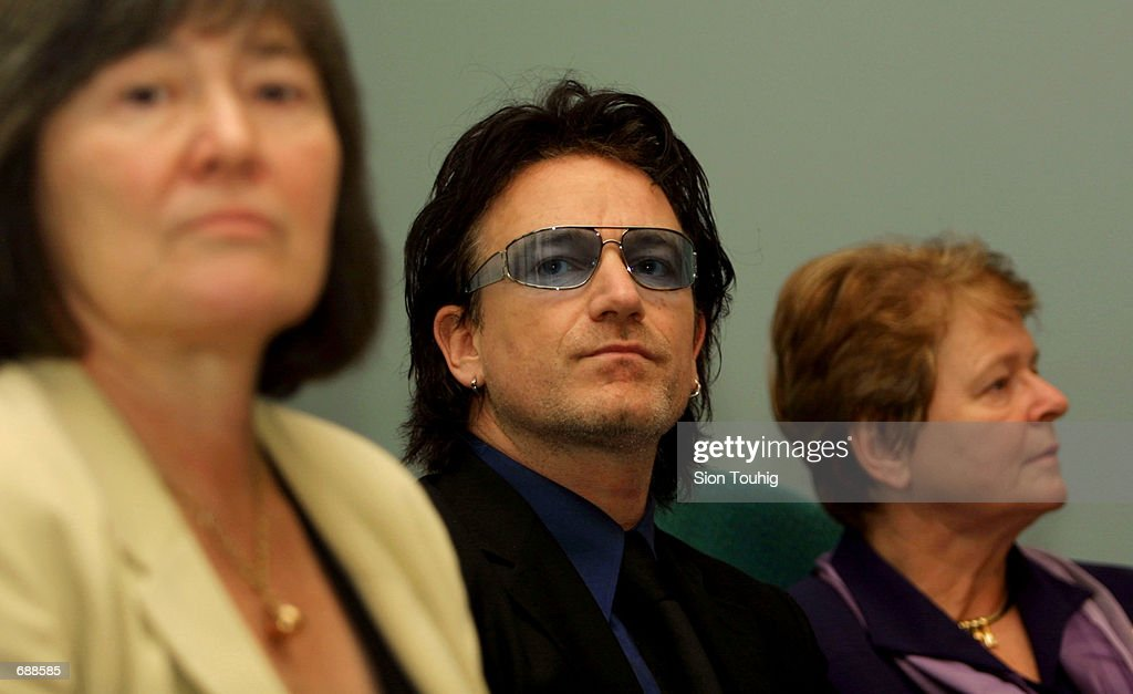 Clare Short, the British Minister for Overseas Development, Bono, the lead singer of U2 and Dr. Gro Harlem Brundtland, the Director General of the World Health Organisation, listen to questions posed by journalists December 20, 2001 at the unveiling of a report, ''Macroeconomics and Health: Investing in Health for Economic Development'' in London. The report calls for major scaling up of investments in health for the poor by presenting scientific evidence that increased spending on health will promote development in poor countries and boost the global economy.