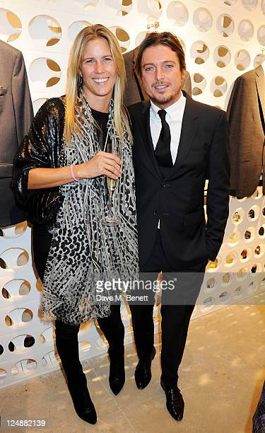 Clare Strowger and Darren Strowger attend the Spencer Hart Brook Street flagship store launch on September 13 2011 in London England