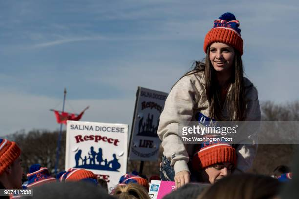 Clare Van Dover sits on Ian Cease's shoulders both 19yearold students at The University of Mary in Bismark North Dakota during the March for Life the...