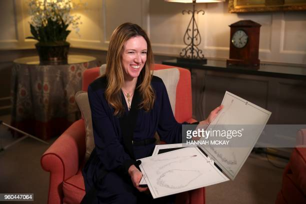 Clare Waight Keller, a fashion designer at Givenchy, holds dress sketches during an interview at Kensington Palace in London on May 20 the day after...