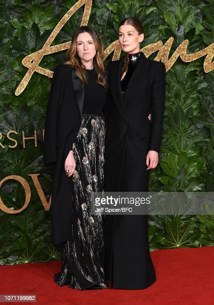Clare Waight Keller and Rosamund Pike arrive at The Fashion Awards 2018 In Partnership With Swarovski at Royal Albert Hall on December 10 2018 in...