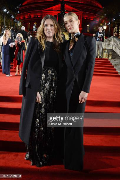 Clare Waight Keller and Rosamund Pike arrive at The Fashion Awards 2018 in partnership with Swarovski at the Royal Albert Hall on December 10 2018 in...