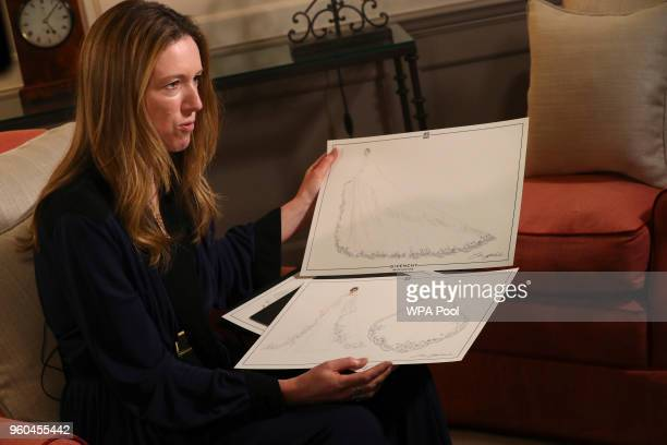 Clare Waight Keller designer at Givenchy holds sketches as she gives an interview the day after the Duchess of Sussex walked down the aisle of St...