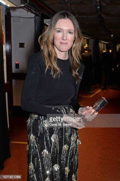 Clare Waight Keller, winner of British Designer of The Year Womenswear award for Givenchy, poses backstage at The Fashion Awards 2018 in partnership...
