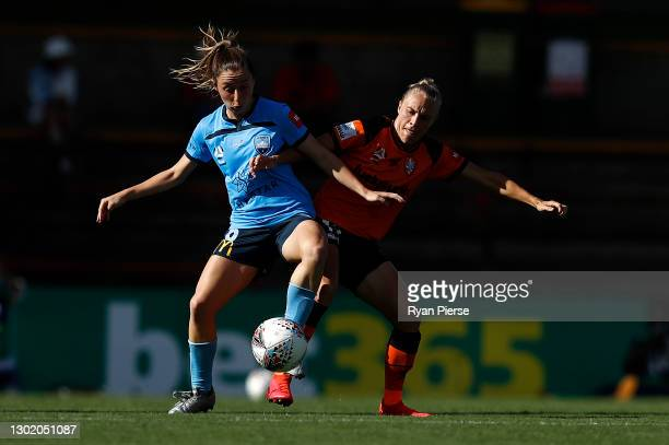 Clare Wheeler of Sydney FC is tacked by Tameka Yallop of the Roar during the round eight W-League match between Sydney FC and the Brisbane Roar at...