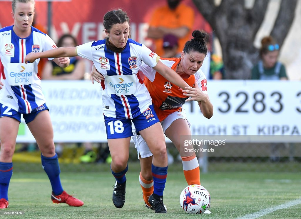 Clare Wheeler of the Jets and Emily Gielnik of the Roar compete for the ball during the round seven W-League match between the Brisbane Roar and the Newcastle jets at AJ Kelly Reserve on December 10, 2017 in Brisbane, Australia.