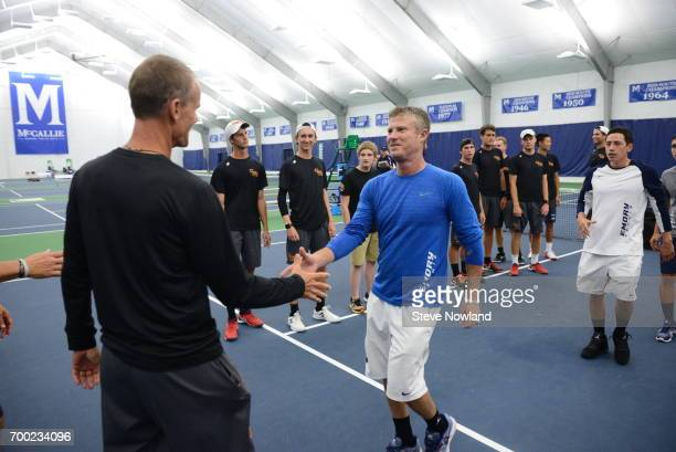 Claremont Mudd Scripps head coach Paul Settles and Emory head coach John Browning shake hands during the Division III Men's Tennis Championship held...