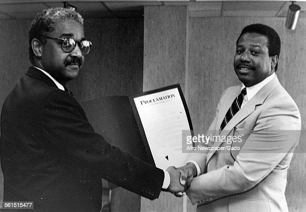Clarence Bishop Executive assistance for the Mayor's Office and John Jake Oliver Junior publisher of the Afro American newspaper Baltimore 1940