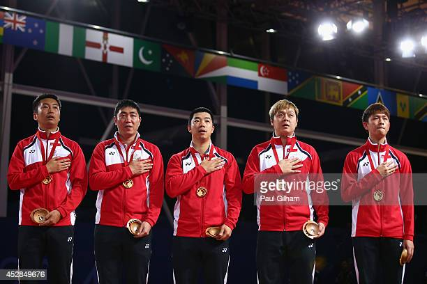 Clarence Chew Ning Gao Hu Li Zi Yang and Jian Zhan of Team Singapore sing the national anthem with their Gold Medals after winning the Gold Medal in...