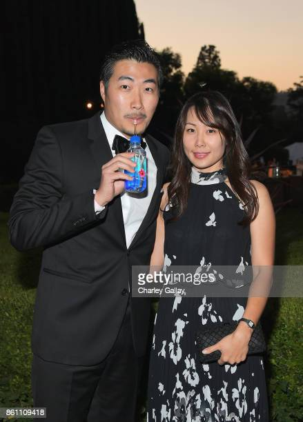 Clarence Chia and Alyssa Chia attend the amfAR Gala Los Angeles 2017 at Ron Burkle's Green Acres Estate on October 13 2017 in Beverly Hills California