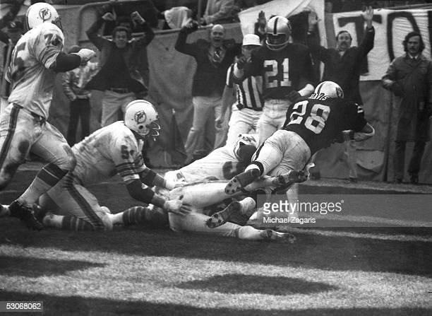 Clarence Davis of the Oakland Raiders scores the winning touchdown on a pass reception against the Miami Dolphins during the 1974 AFC Divisional...