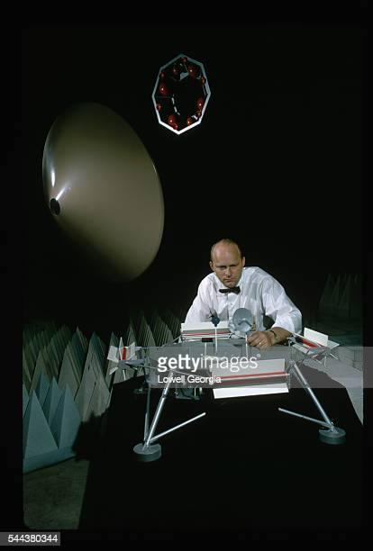 Clarence E Bunnell sets up a model of the Mars Viking spacecraft The lander will transmit pictures from the surface of the planet