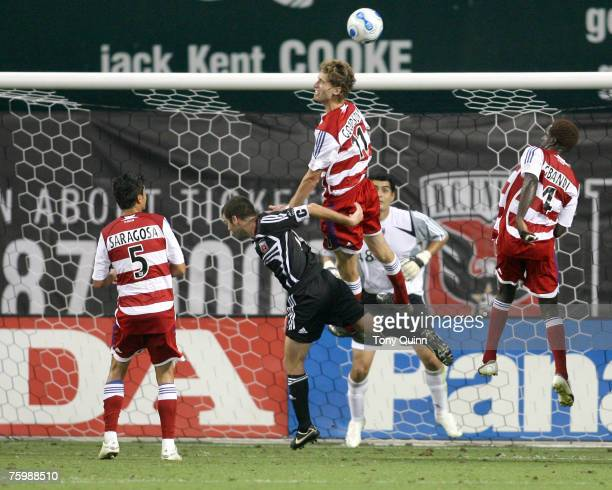 Clarence Goodson of FC Dallas heads the ball clear over Ben Olse of D.C. United during the match between DC United and SC Dallas at RFK Stadium on...