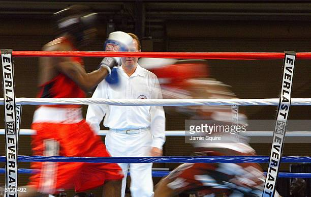 Clarence Joseph battles James Johnson during the United States Olympic Team Boxing Trials at Battle Arena on February 19 2004 in Tunica Mississippi