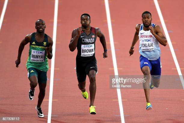 Clarence Munyai of South Africa, Aaron Brown of Canada and Nethaneel Mitchell-Blake of Great Britain competes in the Men's 200 metres heats during...