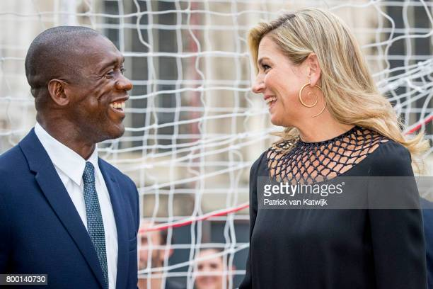 Clarence Seedorf and Queen Maxima of The Netherlands attend a soccer clinic with dutch former players Clarence Seedor Aaron Winter Pierre van...