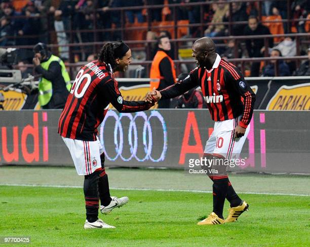 Clarence Seedorf and Ronaldinho of AC Milan celebrate after scoring the goal during the Serie A match between AC Milan and AC Chievo Verona at Stadio...