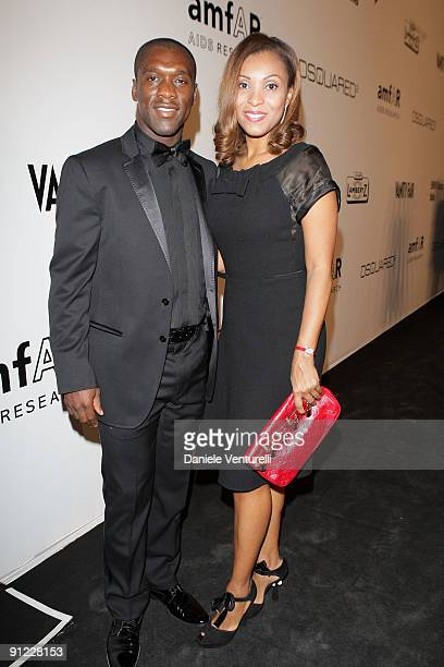Clarence Seedorf and wife Luviana attend amfAR Milano 2009 Red Carpet, the Inaugural Milan Fashion Week event at La Permanente on September 28, 2009...