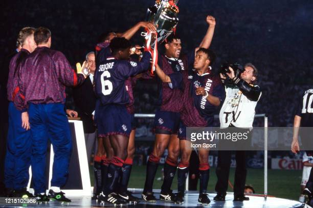 Clarence SEEDORF Frank RIJKAARD and Edgar DAVIDS of Ajax celebrate the victory with the trophy during the Champions League Final match between Ajax...