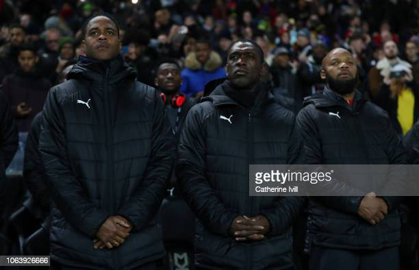 Clarence Seedorf head coach of Brazil stands with assistant Patrick Kluivert prior to the International Friendly match between Brazil and Cameroon at...