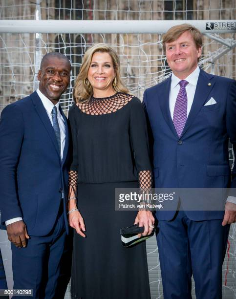 Clarence Seedorf King WillemAlexander of The Netherlands and Queen Maxima of The Netherlands attend a soccer clinic with dutch former players...