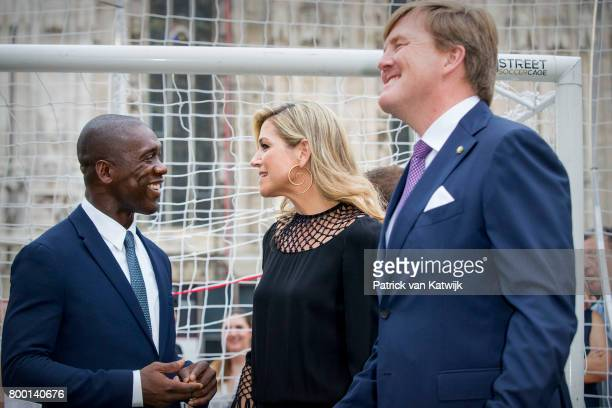Clarence Seedorf, King Willem-Alexander of The Netherlands and Queen Maxima of The Netherlands attend a soccer clinic with dutch former players...