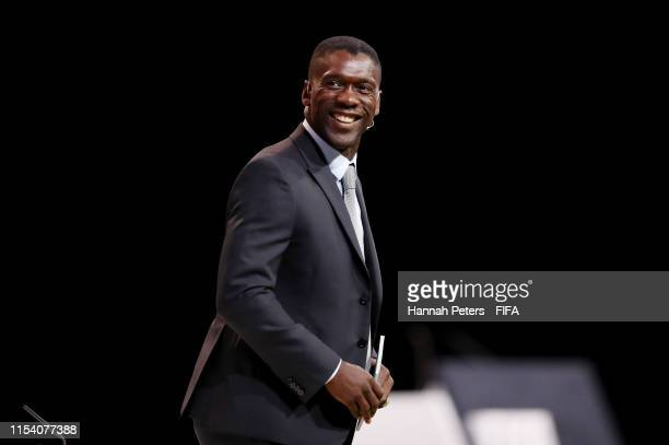 Clarence Seedorf makes his way onto the stage during the FIFA Women's Football Convention at Paris Expo Porte de Versailles on June 06, 2019 in...