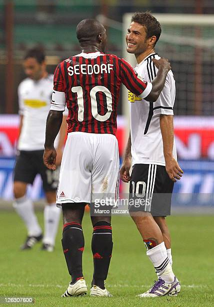Clarence Seedorf of AC Milan and Adrian Mutu of AC Cesena at the end of the Serie A match between AC Milan and AC Cesena at Stadio Giuseppe Meazza on...