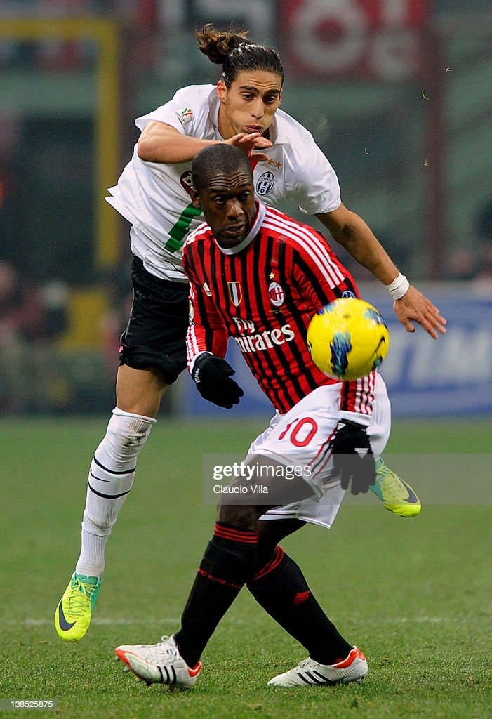 Clarence Seedorf (front) of AC Milan and Martin Caceres of Juventus FC compete for the ball during the Tim Cup match between AC Milan and Juventus FC at Giuseppe Meazza Stadium on February 8, 2012 in Milan, Italy.