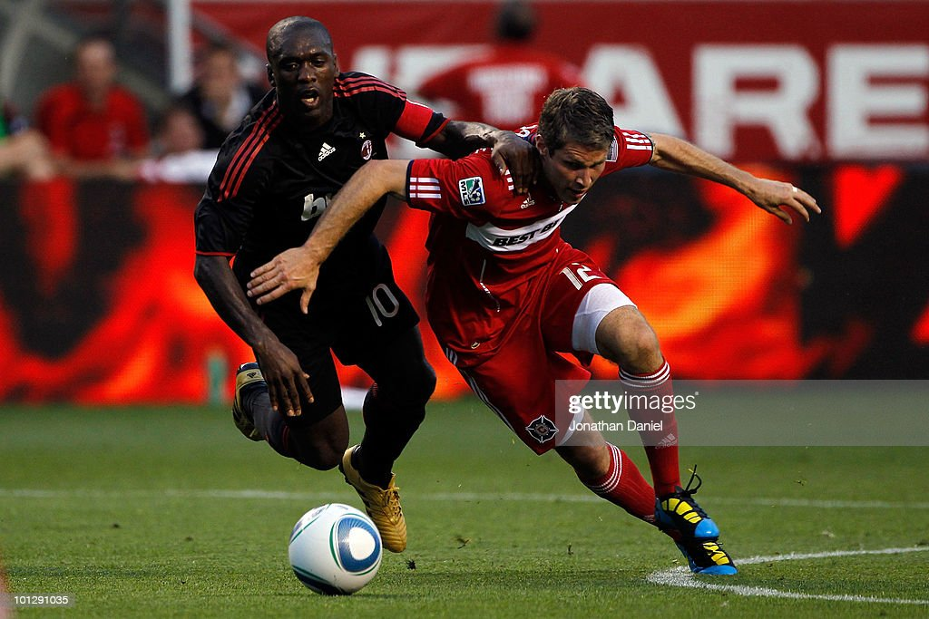 Clarence Seedorf #10 of AC Milan battles for ball alongside Logan Pause #12 of the Chicago Fire in the first half during an international friendly at Toyota Park on May 30, 2010 in Chicago, Illinois.