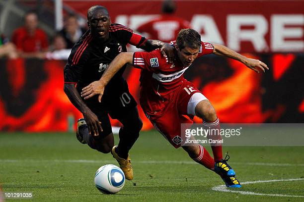 Clarence Seedorf of AC Milan battles for ball alongside Logan Pause of the Chicago Fire in the first half during an international friendly at Toyota...