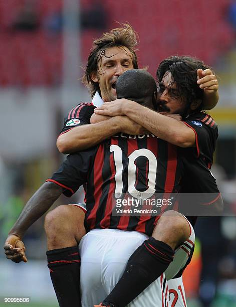 Clarence Seedorf of AC Milan celebrate his goal with Andrea Pirlo and Gennaro Gattuso during the Serie A match between AC Milan and Bologna FC at...
