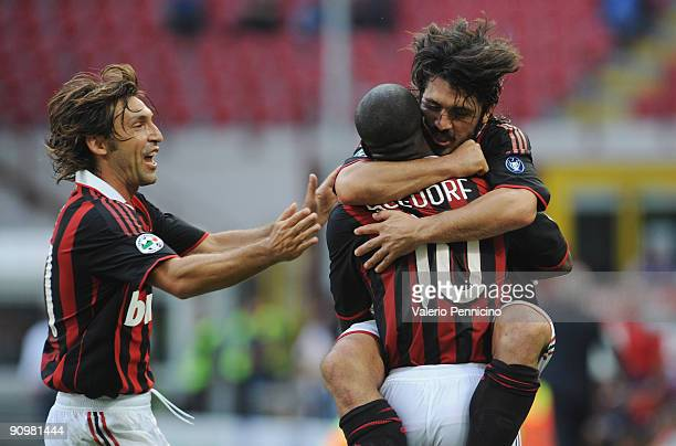 Clarence Seedorf of AC Milan celebrates his opening goal with Gennaro Gattuso and Andrea Pirlo during the Serie A match between AC Milan and Bologna...