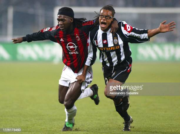 Clarence Seedorf of AC Milan competes for the ball with Edgar Davids of Juventus during the Serie A match between AC Milan and Juvntus at stadio...