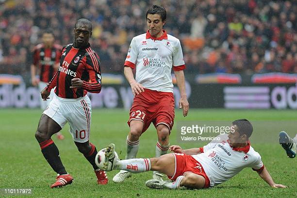 Clarence Seedorf of AC Milan takes on Codrea of AS Bari during the Serie A match between AC Milan and AS Bari at Stadio Giuseppe Meazza on March 13...