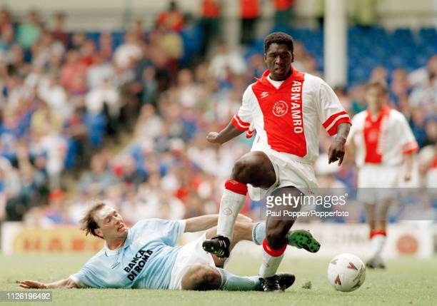 Clarence Seedorf of Ajax is tackled by Dario Marcolin of Lazio during a Makita Tournament match at White Hart Lane on August 1, 1993 in London,...