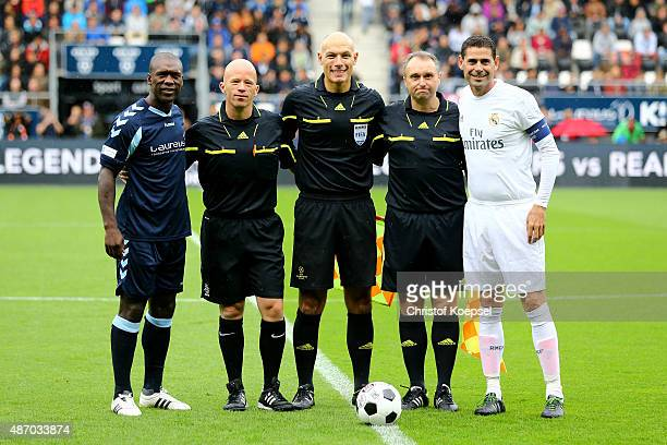 Clarence Seedorf of Laureus Allstaers linesman Gino D'Onorio referee Howard Webb linesman Darren Cann and Fernando Hierro of Real Madrid Legends pose...