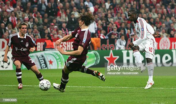 Clarence Seedorf of Milan scores the first goal whilst Daniel van Buyten of Munich and his team mate Philipp Lahm reacts during the UEFA Champions...