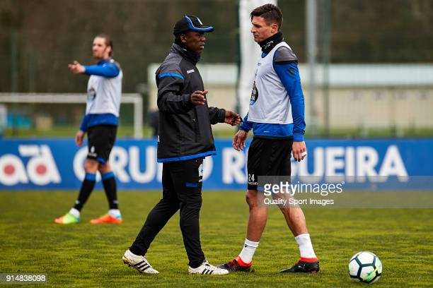 Clarence Seedorf the new manager of Deportivo de La Coruna gives instructions to Fabian Schar of Deportivo de La Coruna during his first training...